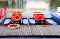 Pedalo on lake and life buoy Royalty Free Stock Photo