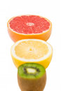 Pedestal fruit light fruit kiwi grapefruit lemon a Stock Image