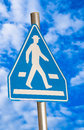 Pedestrian blue traffic sign isolated on sky background Royalty Free Stock Photo