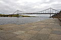 Pedestrian bridge across the dnieper river in kiev under overcast sky Royalty Free Stock Image