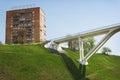Pedestrian bridge of concrete across deep ravine is built Royalty Free Stock Photo