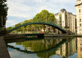 Pedestrian bridge over Saint-Martin canal in Paris Royalty Free Stock Photo