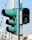 Pedestrian crossing lights and traffic lights green grey light portrait cut Stock Images