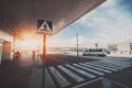 Pedestrian crossing next to airport entrance Royalty Free Stock Photo