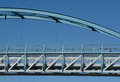 Pedestrian suspension bridge close up architectural detail abstract of against blue sky Royalty Free Stock Photos