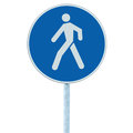 Pedestrian walking lane walkway footpath road sign on pole post, large blue round isolated route traffic roadside signage closeup Royalty Free Stock Photo