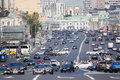 Pedestrians and cars turning left on the Garden Ring in Moscow