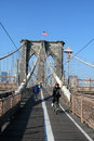 Pedestrians crossing brooklyn bridge at sunny day new york city january on january about and bicyclists cross the Royalty Free Stock Photos