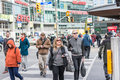 Pedestrians crossing a busy intersection toronto on canada october near dundas square on young street in toronto canada on october Royalty Free Stock Images