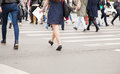 Pedestrians on a pedestrian crossing legs of spring day Royalty Free Stock Images