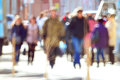Pedestrians on the street blurred background bokeh city passers by Royalty Free Stock Photography