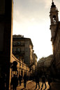 Pedestrians in turin on the streets of italy the morning light Royalty Free Stock Images