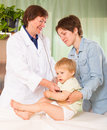 Pediatrician doctor examining baby girl with stethoscope at clinic office focus on child Stock Photography