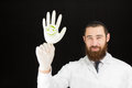 Pediatrician doctor holding inflated glove bearded with drawing of jewish boy on it Stock Photography