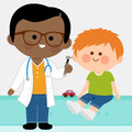 Pediatrician examining a little boy Royalty Free Stock Photo