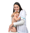 Pediatrician woman doctor holding in her arms smiling child baby Royalty Free Stock Photo