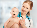 Pediatrician women doctor holding in his arms patient baby Royalty Free Stock Photos