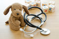 Pediatrics puppy toy with medical equipment Royalty Free Stock Images