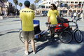 Pedicab drivers the two men pedi cab driver are waiting for the riders to take for a ride around downtown huntington beach Royalty Free Stock Images