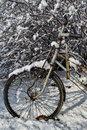 A pedicab tyre covered by the snow in outside Royalty Free Stock Photos