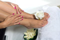 Pedicure on foot woman spa treatment with water and flower Stock Images