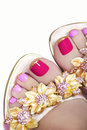 Pedicure with golden flowers two tone stripes on the end of the nail in sandals on a brilliant background Stock Images