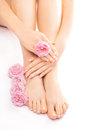 Pedicure and manicure with a pink rose flower Royalty Free Stock Photo