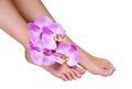 Pedicure with pink orchid flowers isolated on white Royalty Free Stock Photos