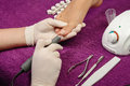 Pedicure process close up polishing fingernail unrecognizable people Stock Photo
