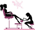 Pedicure silhouette of girl making in beauty salon Royalty Free Stock Photo