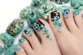 Pedicure with turquoise stones and jewelry made of on the women s foot Royalty Free Stock Photo