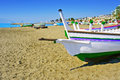 Pedregalejo beach in malaga spain traditional fishing boats on city Stock Image