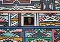Peeking from Ndebele house Royalty Free Stock Images