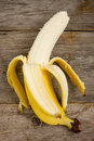 Peeled  banana on the wood background Stock Image