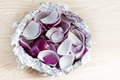 Peeled and chopped red onions in tin foil Royalty Free Stock Photo