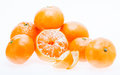 Peeled mandarin tangerine orange fruit isolated on white backgro tasty sweet background Stock Photos