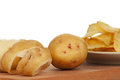 Peeled new potato crispy chips white background close up Stock Photo