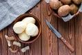 Peeled potatoes next to the skin Royalty Free Stock Photo