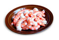 Peeled red shrimps on the plate Stock Photos