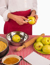 Peeling apples for pie female hands fresh to prepare a traditional Stock Image