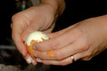 Peeling a boiled egg with your hands Royalty Free Stock Photo