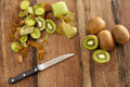 Peeling and dicing kiwifruit for dessert overhead view of a wooden kitchen counter with a knife fresh kiwi fruit that are being Royalty Free Stock Photography