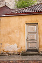 Peeling door and crumbling wall Royalty Free Stock Photo