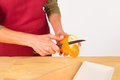 Peeling an orange Stock Photo