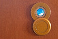 Peephole and sky on a wooden door Stock Photography