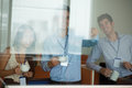 Peeping colleagues three office workers watching their through window and laughing Royalty Free Stock Photos