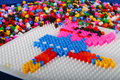 Pegboard and Beads Craft Stock Images