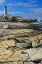 Peggy s cove lighthouse vertical on the big rock nova nova scotia canada Stock Image