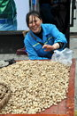 Pegzhou, China: Woman Selling Peanuts Stock Photos