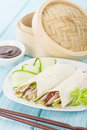 Peking duck chinese roast crispy cucumber and spring onions wrapped in pancakes served with hoisin sauce Stock Image
